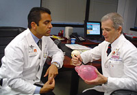 Image: Physicians discussing while at desk.