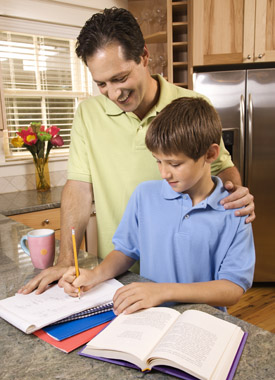 Child with father doing homework